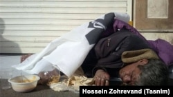 Iran -- An Iranian homeless sleeping outdoor.