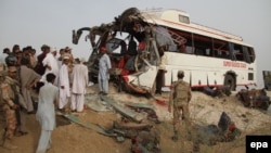 FILE: The aftermath of a traffic accident in southren Pakistan.