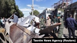 FILE: The aftermath of a suicide bombing attack outside a police station in the port city of Chabahar in Iran's southeastern province of Sistan-Baluchistan.