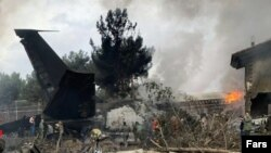 Iran -- Iranian media reported a Boeing 707 cargo plane crashed west of Tehran.