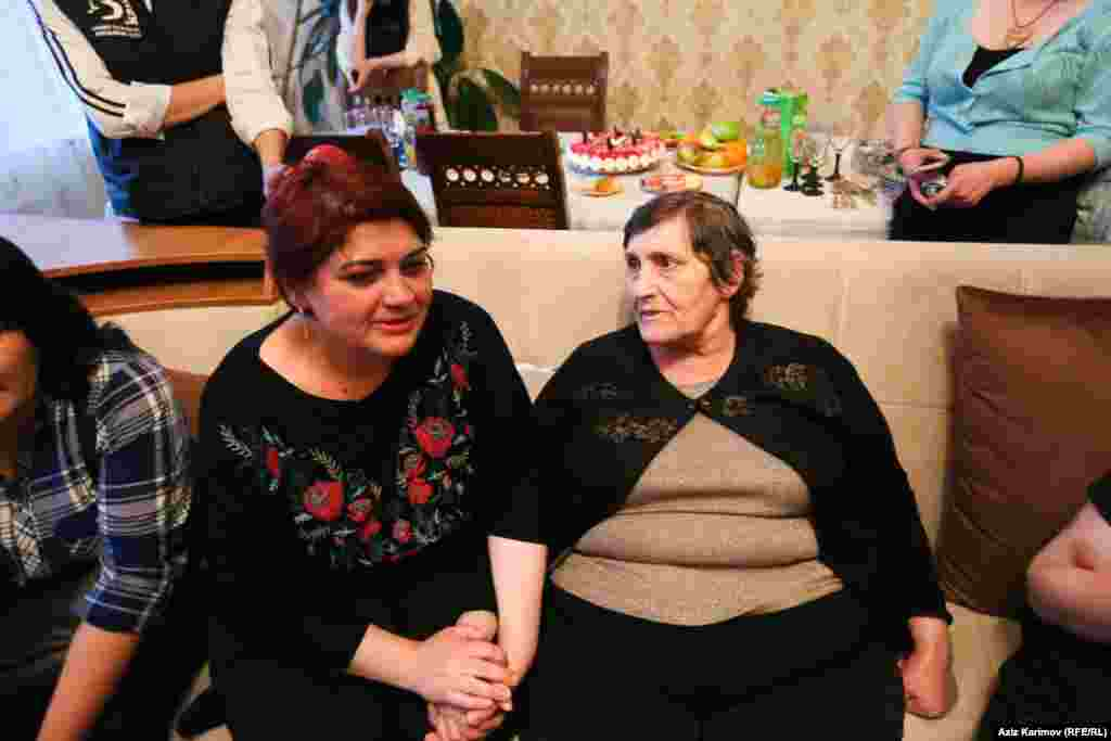 Khadija sits with her mother, Elmira.