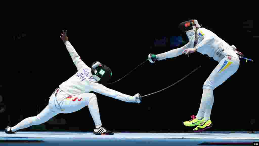 Anqi Xu of China battles Ukraine's Olena Kryvytska (R) in a women's epee team quarterfinal match.