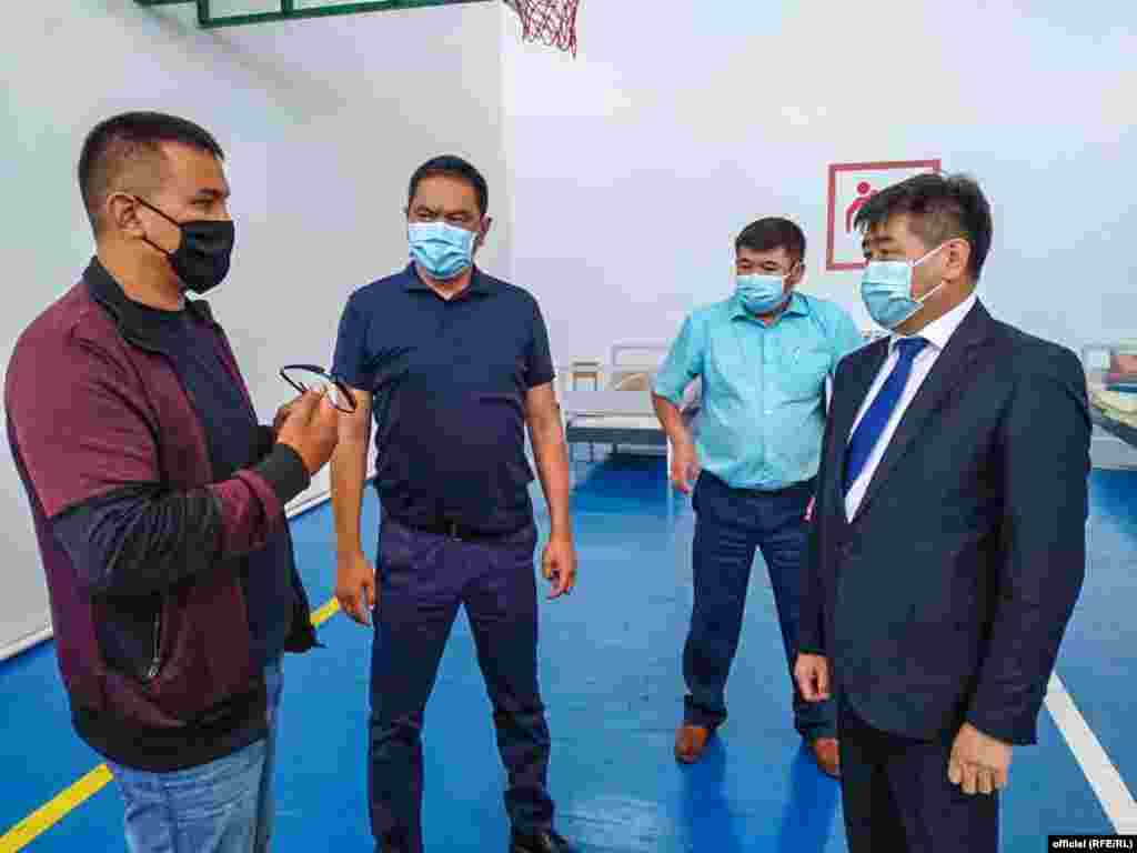 Government official Akylbek Osmonaliev (right) inspects makeshift hospitals in the Issyk-Kul region.