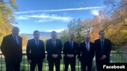 Armenian Foreign Minister Zohrab Mnatsakanian (second from right), Azerbaijani Foreign Minister Jeyhun Bayramov (second from left) and international mediators in Geneva, Switzerland, October 30, 2020