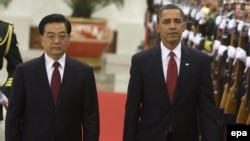 U.S. President Barack Obama (right) walks with Chinese President Hu Jintao during a welcoming ceremony at the Great Hall of the People in Beijing, November 2009.