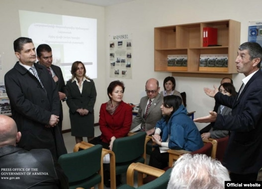 Armenia -- Prime Minister Tigran Sarkisian (L) and U.S. Ambassador Marie Yovanovitch (C) meet with beneficiaries of U.S. assistance provided under the Millennium Challenge Account program, 15Apr2011.