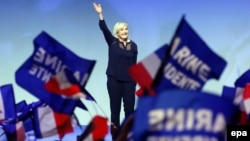 France -- Marine Le Pen, the leader of France's far-right Front National political party and candidate for the 2017 French presidential elections, waves to cheering supporters during a presidential campaign rally in Metz, March 18, 2017