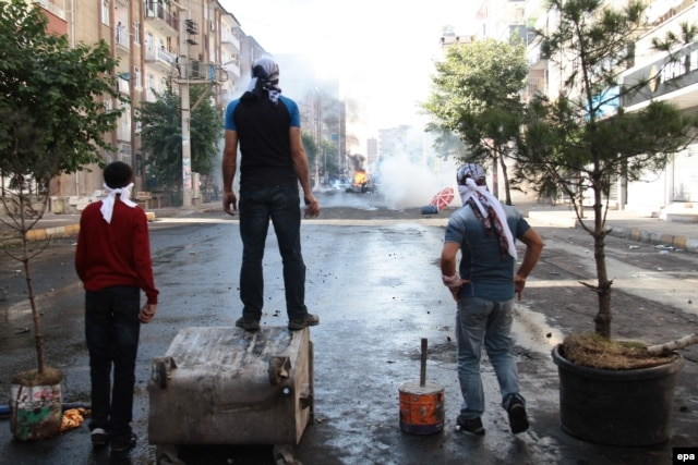Protesters clash with riot police during a demonstration against Islamic State in Diyarbakir in southeastern Turkey on October 7.