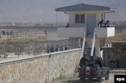 FILE: Afghan security forces stand guard at Pol-e Charkhi prison.