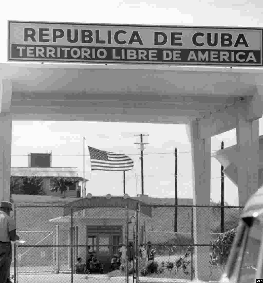 A sign above the entrance to the U.S. naval base in Guantanamo Bay, Cuba in February 1962, six months before the crisis, reads: Republic of Cuba -- American free territory