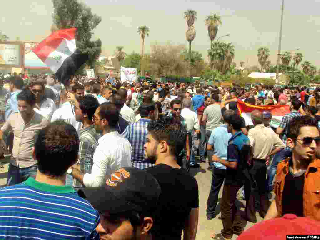 Demonstrators rally against high pensions and benefits for Iraqi parliament members in Baghdad on August 31.