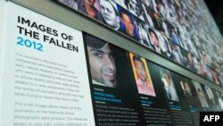 Faces of fallen journalists on the Newseum's Journalists Memorial is seen at the Newseum in Washington, D.C. (File Photo -- 2013)
