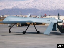 A U.S. Predator unmanned drone leaves its hangar at Bagram air base in Afghanistan in 2009.