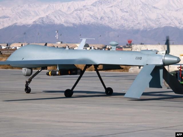 A U.S. Predator unmanned drone leaves its hangar at Bagram air base in Afghanistan in 2009.