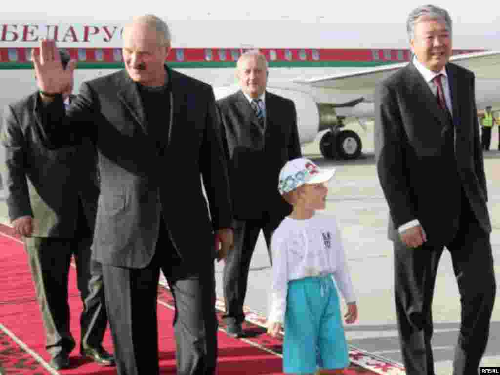 Lukashenka and Kolya arrive in Bishkek in July 2009.