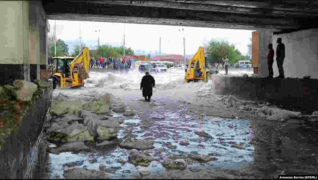 Clumps of ice under a railway bridge in Gyumri on July 14   As the cleanup continued and local authorities counted the cost of the damage, Naira Grigorian said on July 15 that chunks of ice remained on the streets in some parts of the city -- despite balmy temperatures of 28 degrees Celsius.