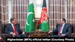 Afghan Foreign Minister Salahuddin Rabbani (R) met his Pakistani counterpart Shah Mehmood Qureshi in Kabul on December 24.