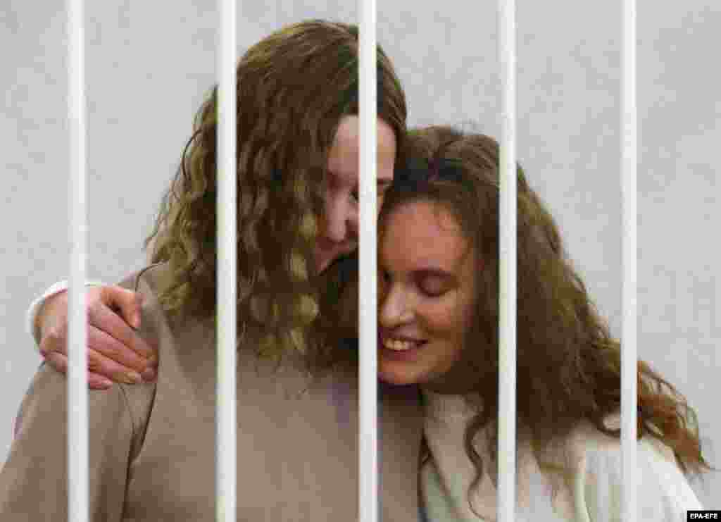 Journalists Katsyaryna Andreyeva (right) and Darya Chultsova embrace in the defendants' cage before the start of a trial in Minsk. The journalists from the Polish-funded Belsat TV channel were detained in November when they were reporting on anti-government protests. They face up to three years in prison on charges of organizing and preparing actions that grossly violate public order. (epa-EFE/Stringer)