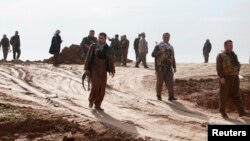 Kurdish Peshmerga fighters during a battle against Islamic State militants on the outskirts of Mosul on January 21.