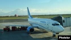 Armenia - A passenger jet at Yerevan's Zvartnots international airport, 10Apr2017.