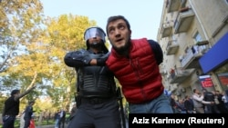 A man is detained during a rally in Baku on October 20.