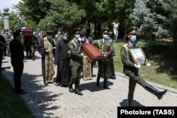 Armenian soldiers take part in the funeral in Yerevan on July 16 of Mayor Garush Hambardzumian, who was killed during clashes in the Tavush region.