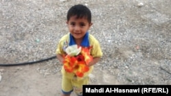 Iraq - A child with flower from Naseriya, August 2011