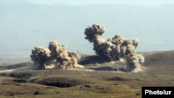 Armenia - Explosions caused by heavy artillery fire during CSTO military exercises at the Marshal Bagramian training ground, 19Sep2012.