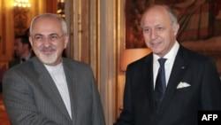 Переговорам у Женеві передувала зустріч міністрів закордонних справ Ірану Джавада Заріфа (ліворуч) і Франції Лорана Фабіуса, Париж, 5 листопада 2013 року