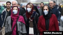 Iranian women wear protective masks in Tehran's Grand Bazaar after five cases of the coronavirus were confirmed in the country on February 20.