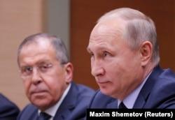 Сергей Лавров и Владимир Путин на встрече c премьер-министром Бельгии Шарлем Мишелем. Ново-Огарево, 31 января 2018 года