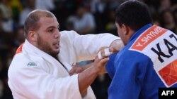Қазақ балуаны Ержан Шынкеев (оң жақта) пен Тунис спортшысы Файсел Жабаллаһтың күресі. 3 тамыз 2012 ж.