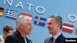 U.S. Secretary of State Rex Tillerson (left) greets NATO Secretary-General Jens Stoltenberg during the alliance's foreign ministers meeting in Brussels on March 31.