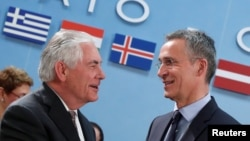 U.S. Secretary of State Rex Tillerson (left) greets NATO Secretary-General Jens Stoltenberg during a NATO foreign ministers meeting at the alliance's headquarters in Brussels in March 31.