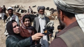 Afghanistan -- Azadi Radio reporter speaks with the people at the animal market in Kabul in November, 2011.