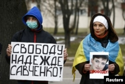 People take part in a protest in front of the Russian Embassy in Minsk on March 21 demanding the liberation of Ukrainian pilot Nadia Savchenko by Russia.
