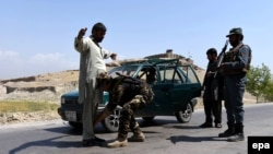 Afghan security officials frisk a man on a roadside as security has been intensified since the Taliban announced the start of their annual spring offensive, in Jalalabad, on April 28.