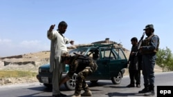 Afghan security officials frisk a man on a roadside as security has been high intensified after Taliban announced the start of their annual spring offensive, in Jalalabad, on April 28.
