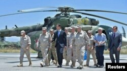Syrian President Bashar al-Assad visits a Russian air base in Syria last month.