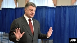 Ukrainian President Petro Poroshenko talks to the media after voting in Kyiv.