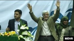 Mohammad Reza Aref (center) and his wife during campaigning