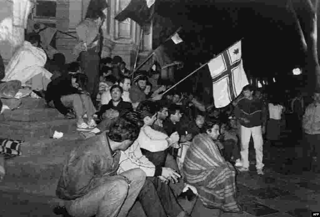 By April, the protest movement had swelled. Here, pro-independence demonstrators sit on Rustaveli Avenue in Tbilisi on April 8, 1989. A small faction protesting against separatism in the Georgian Black Sea region of Abkhazia was also present.