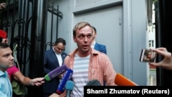 Ivan Golunov talks to the press after being released on June 11.