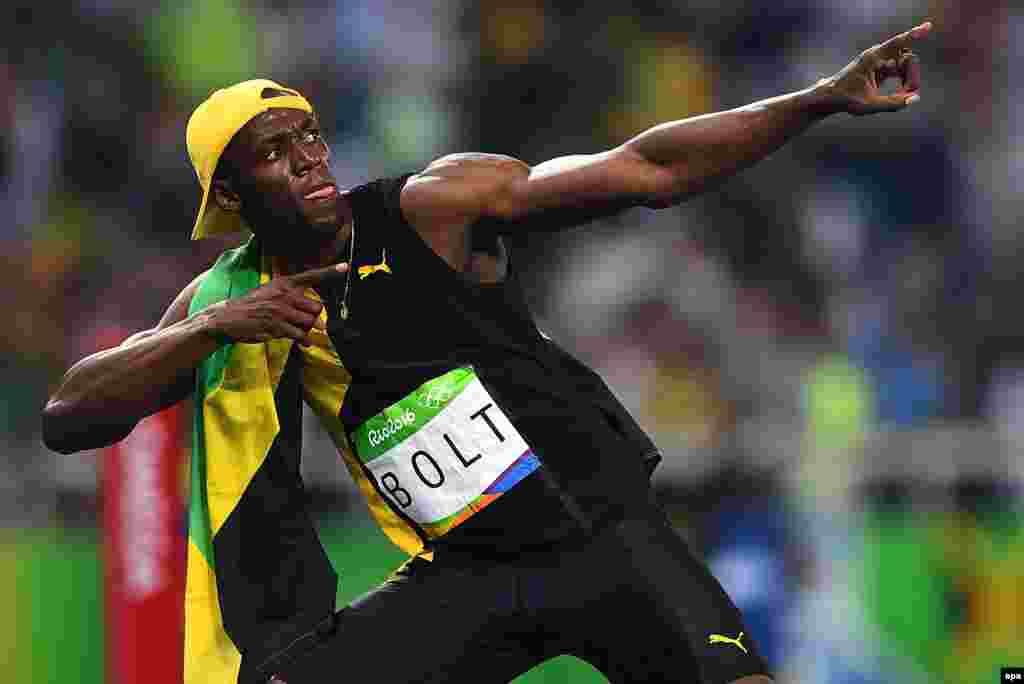 Usain Bolt of Jamaica celebrates after placing first in the men's 100-meter race, making him the first person to win three consecutive Olympic gold medals in that event. The sprinter clocked 9.81 seconds in the final in Rio on August 14.