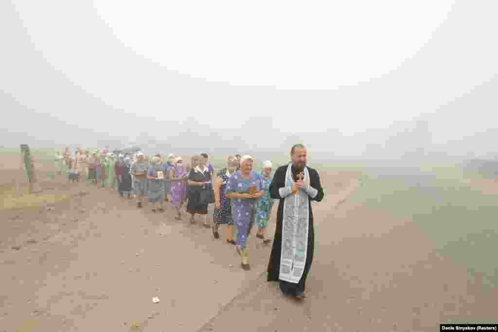 "According to Russia's official TASS news agency, churches in regions affected by the current blazes are organizing ""special services to pray for heavy rains."" The practice is not new; this image of a similar service was taken during wildfires in Siberia in 2010."