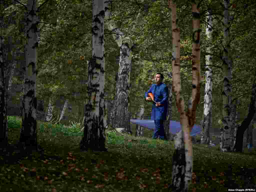 Before the competition in musical improvisation, the competitors could be seen ambling through the woods behind the stage, practicing their craft. Nurmat Mansur, pictured with his dombra, works as a radio journalist back home in Kazakhstan.