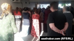 People line up to buy food at a state grocery store in Ashgabat last month.