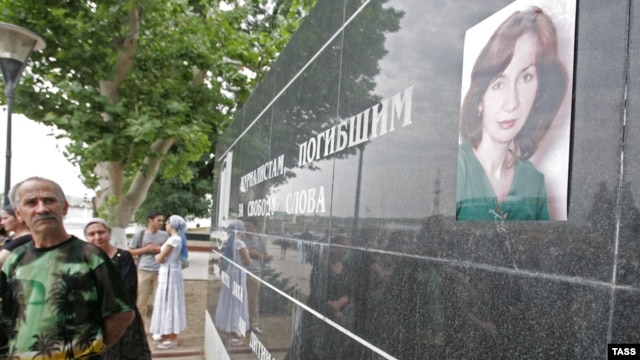A portrait of slain rights activist Natalya Estemirova on a memorial in Grozny to journalists who have died in the fight for free speech