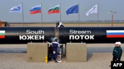 Workers weld pipes during the symbolic start of the construction of the Bulgarian section of the South Stream pipeline near the Bulgarian village of Rasovo on October 31, 2013.