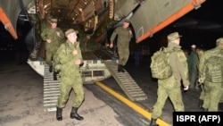 Russian troops arrive at a Pakistani military base at an undisclosed location on October 22.